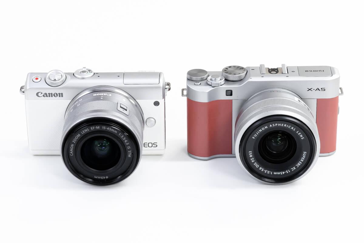 Canon EOS M100とFUJIFILM X-A5を徹底比較。格安、小型、軽量を実現した初心者向け両モデルの違いを検証